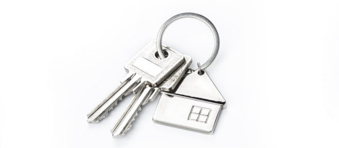 Key placed on top of white background,Purchase concept